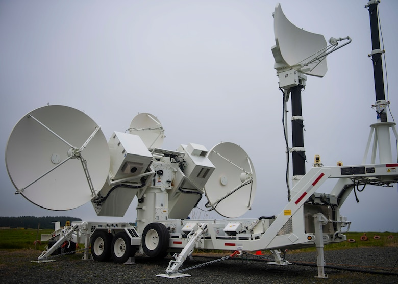Satellite dishes on a Joint Threat Emitter spin while operated by defense industry partners.
