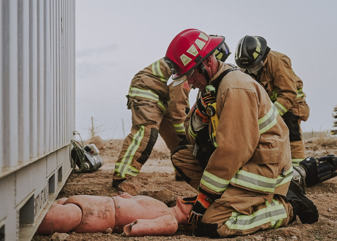 The 776th Air Expeditionary Air Base Squadron firefighters remove a dummy from a simulated danger scenario during the medical evacuation exercise May 31, 2021, at Chabelley Airfield, Djibouti. The exercise consisted of various simulated patients in need of emergency treatment.  The medics triaged, assessed and stabilized patients in order to be sent from Chabelley Airfield to Camp Lemonnier whether by ground or air. (U. S. Air Force photo by Airman 1st Class Jan K. Valle)