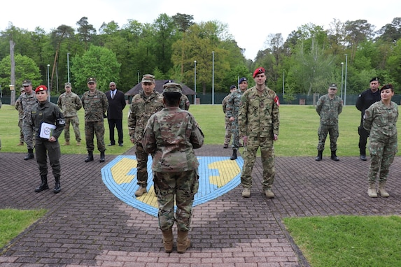 U.S. Army Reserve Brig. Gen. Wanda N. Williams, commanding general of the 7th Mission Support Command and joint security coordinator for the Joint Security Coordination Center, addresses a formation of U.S. Army, NATO Allies, and Partnership for Peace Soldiers on Panzer Kaserne in Kaiserslautern, Germany, May 27, 2021. U.S. Army Reserve Soldiers and Civilians assigned to the 7th MSC teamed up with NATO Allies and partners from 18 different countries to provide a unique protection capability for U.S. Army Europe and Africa by serving as the JSCC in support of DEFENDER Europe 21. (U.S. Army Reserve Photo by Capt. Lorenzo Llorente)