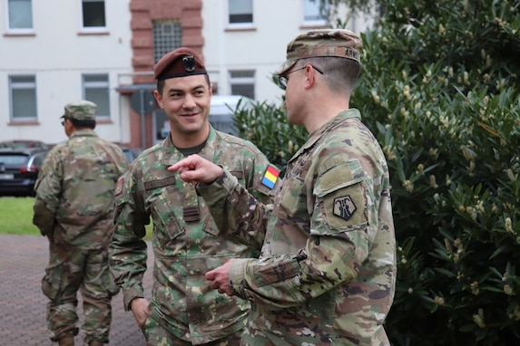 U.S. Army Reserve Col. Jason Ardnt, chief of staff of the 7th Mission Support Command and deputy joint security coordinator for the Joint Security Coordination Center, speaks with Romanian military police officer Capt. Razvan Matran on Panzer Kaserne in Kaiserslautern, Germany, May 27, 2021. U.S. Army Reserve Soldiers and Civilians assigned to the 7th MSC teamed up with NATO Allies and partners from 18 different countries to provide a unique protection capability for U.S. Army Europe and Africa by serving as the JSCC in support of DEFENDER Europe 21. (U.S. Army Reserve Photo by Capt. Lorenzo Llorente)