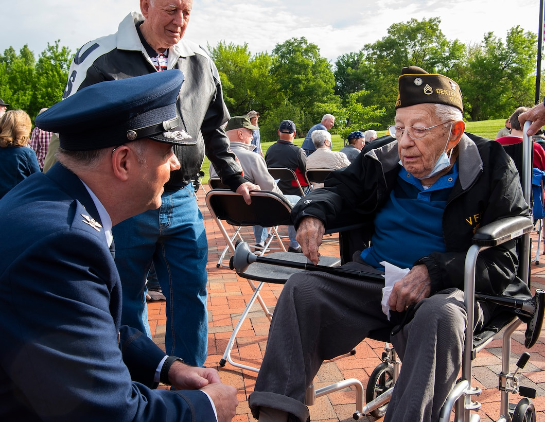 U.S. Air Force Col. Michael Phillips, 88th Air Base Wing vice commander, visits with Ken Snavely, a 103-year-old veteran who served with the 8th Air Force in World War II, prior to the Centerville, Ohio, Memorial Day ceremony May 31, 2021. Phillips was the event's keynote speaker. (U.S. Air Force photo by R.J. Oriez)
