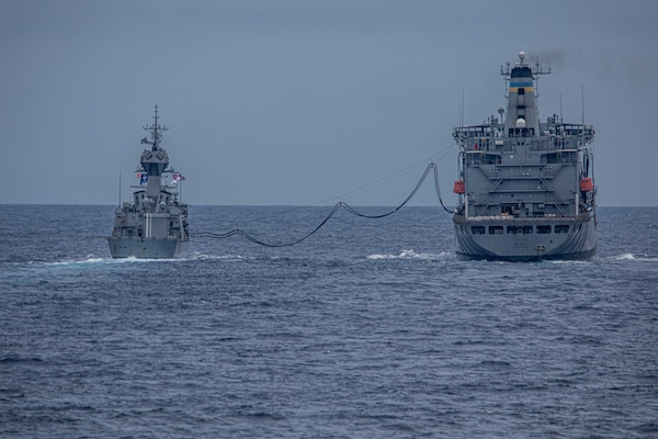 The Royal Australian Navy Anzac-class frigate HMAS Ballarat (FFH 155) steams ahead of Arleigh Burke-class guided-missile destroyer USS Curtis Wilbur (DDG 54) during a replenishment-at-sea with the Military Sealift Command Henry J. Kaiser Class fleet replenishment oiler USNS Big Horn (T-AO 198). Curtis Wilbur is assigned to Commander, Task Force 71/Destroyer Squadron (DESRON) 15, the Navy's largest forward-deployed DESRON and U.S. 7th Fleet's principal surface force.