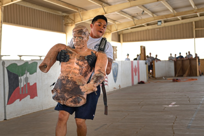 A photo of an Airman carrying a simulated victim