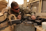 Georgia Army National Guard Spc. Michael Brannon of the 148th Brigade Support Battalion performs maintenance on a Humvee in Tan-Tan, Morocco, June 8, 2021, during the African Lion 21 exercise. More than 7,000 participants from nine nations and NATO train together to enhance readiness.