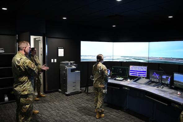Female Airman using air traffic control simulator
