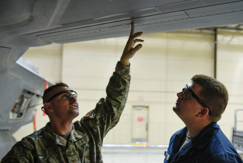 Staff Sgt. Robert Briones, 62nd Aircraft Maintenance Unit crew chief, and Airman 1st Class Todd Combe, 61st AMU crew chief, inspect an outer mold line on the wing of an F-35A Lightning II aircraft June 4, 2021, at Luke Air Force Base, Arizona. Maintenance Airmen conduct OML inspections to track any exterior damage on the aircraft before and after flight; the OML inspection is one of the techniques taught within the Lightning Technician Program. The efforts of LTP cost-effectively modernizes Luke's F-35 maintenance operations as a whole by creating multi-capable Airmen. (U.S. Air Force photo by Airman 1st Class David C. Busby)