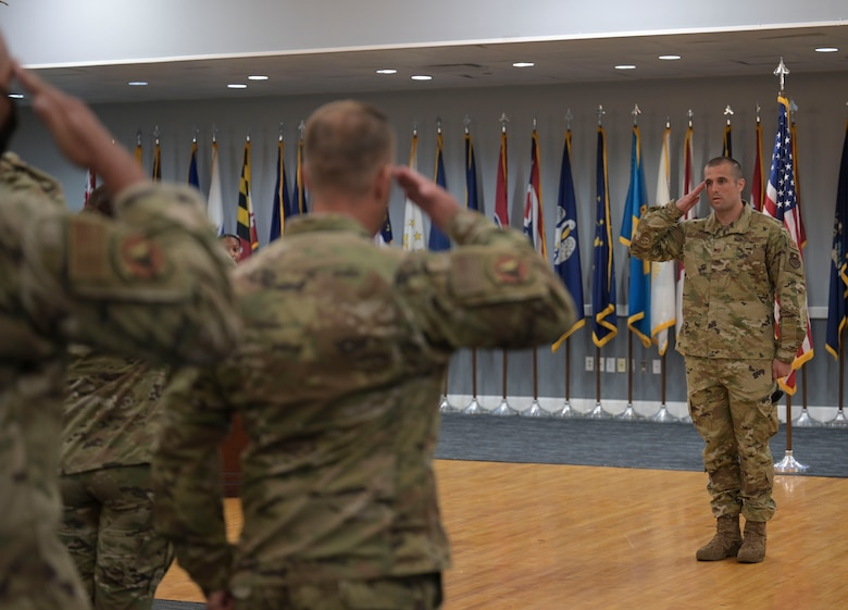 U.S. Air Force Maj, Michael Olson, incoming 14th Security Forces Squadron commander, salutes his new unit during a change of command ceremony, June 11, 2021, on Columbus Air Force Base, Miss. The 14th SFS is responsible for wing resource protection valued at over $340 million, crime prevention, unit security programs and combat arms. (U.S. Air Force photo by Airman 1st Class Jessica Haynie)