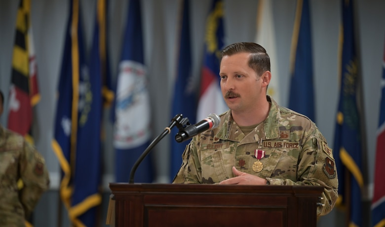 U.S. Air Force Maj. Cody Elliot, outgoing 14th Security Forces Squadron commander, thanks many personnel who has impacted his career as commander during a change of command ceremony, June 11, 2021, on Columbus Air Force Base, Miss. Elliott worked tirelessly to bring advancements to the 14th SFS such as a new armory which resulted in defenders being more proficient during turn-over times.  (U.S. Air Force photo by Airman 1st Class Jessica Haynie)