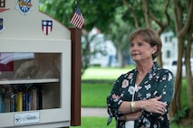 Nell Calloway, president of the Chennault Museum, stands next to the new community book exchange box at Barksdale Air Force Base, June 8, 2021. Calloway is the granddaughter of Lt. Gen. Claire Chennault, to whom the book exchange box is dedicated.