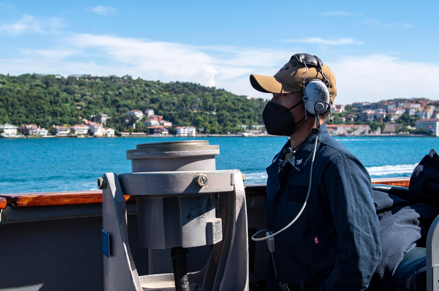 Culinary Specialist 3rd Class Jubidane Maraton, assigned to the Arleigh Burke-class guided-missile destroyer USS Laboon (DDG58), stands lookout watch as Laboon transits en route to the Black Sea, June 11, 2021.