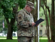 Lt. Col. Richard Holmes, 2nd Bomb Wing unit chaplain, delivers the invocation for the new community book exchange box at Barksdale Air Force Base, June 8, 2021. The exchange box is located on Chennault Avenue and is dedicated to honor Lt. Gen. Claire Chennault's exemplary service.