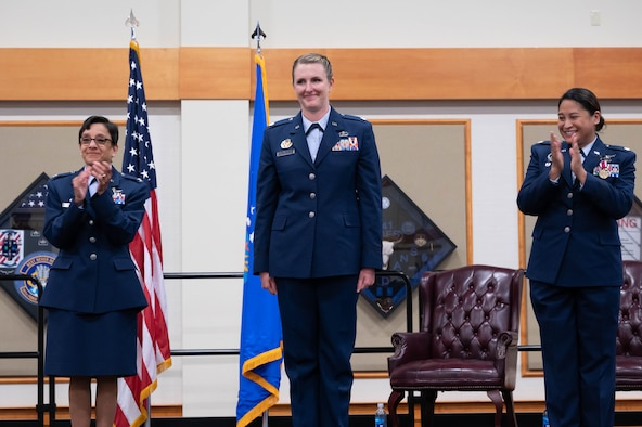 Col. Lisa Martinez, left, 341st Mission Support Group commander, and Maj. Kristina Eclevia, right, 341st Force Support Squadron outgoing commander, clap for Lt. Col. Corrie Pecoraro, center, 341st FSS incoming commander during a change of command ceremony June 11, 2021, at Malmstrom Air Force Base, Mont.