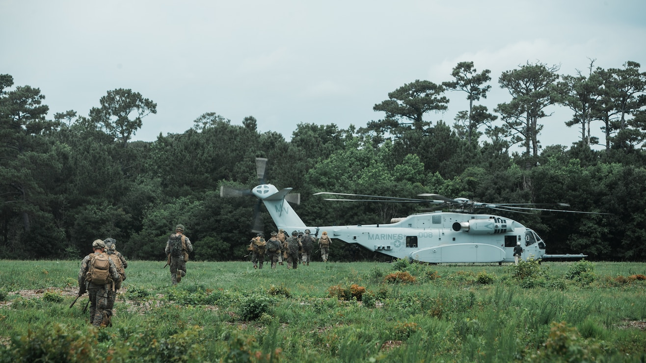 U.S. Marines with Alpha Company, 1st Battalion, 2d Marine Regiment (1/2), 2d Marine Division (MARDIV) sprint to a CH-53K King Stallion in Camp Lejeune, N.C., June 10, 2021. Marines with Alpha Company, 1st Battalion, 2d Marine Regiment, 2d Marine Division, executed an air assault operation in support of VMX-1 to test the capabilities of the CH-53K King Stallion, the U.S. Marine Corps' newest heavylift helicopter. (U.S. Marine Corps photo by Cpl. Patrick King)