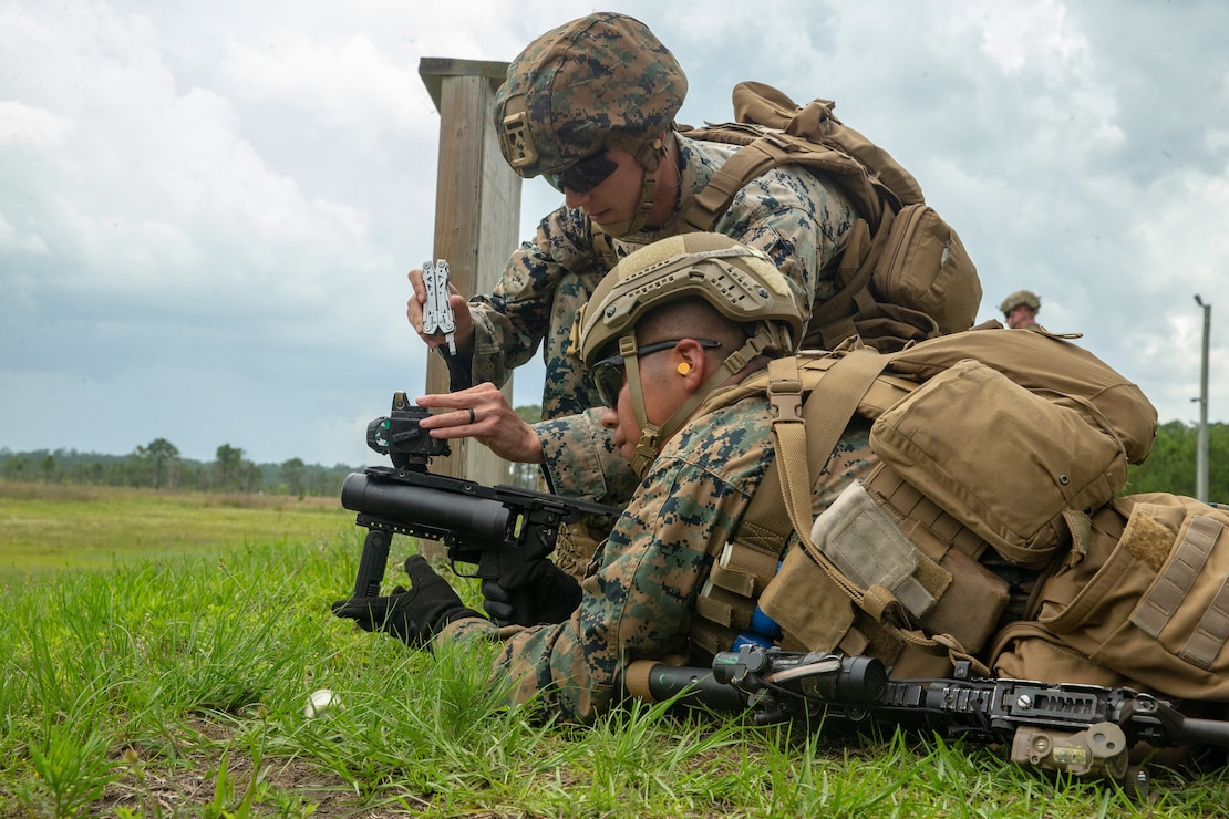 U.S. Marine Corps Cpl. Christian Wright and Lance Cpl. Brian Cifuentesperez, both infantry rifleman with 2d Battalion, 6th Marine Regiment, 2d Marine Division, adjust the optic of the M320 grenade launcher during a live-fire range on Camp Lejeune, N.C., June 10, 2021. Marines from 6th Marine Regiment utilized the M320, which is gradually being adopted throughout the Marine Corps, for the first time to strengthen readiness and improve lethality for the next fight. (U.S. Marine Corps photo by Cpl. Alize Sotelo)