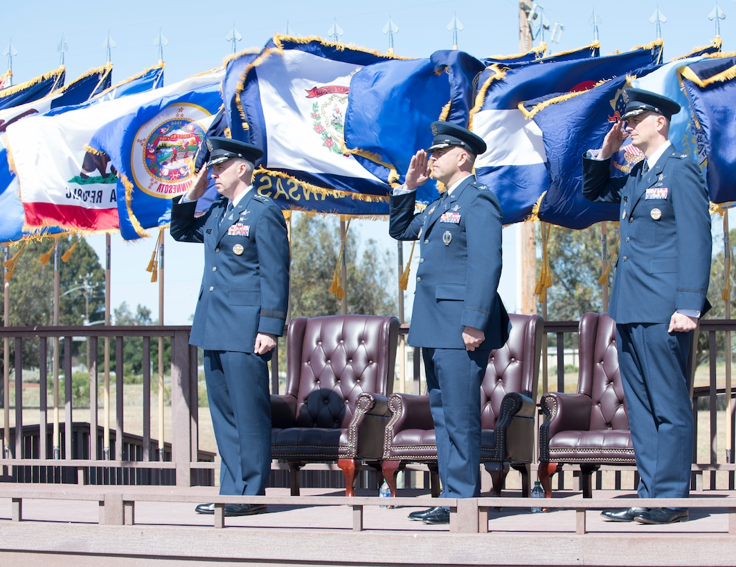 Lt. General Stephen N. Whiting, Space Operations Command commander and presiding officer, Col. Anthony J. Mastalir, outgoing Space Launch Delta 30 commander and Col. Long, Space Launch Delta 30 commander, salute Vandenberg members during a change of command ceremony on June 11, 2021, Vandenberg Space Force Base, Calif. As the new commander of SLD 30, Long will command spacelift and range operations in support of national and combatant commander requirements, and support operational and developmental missile system testing for the Department of Defense. (U.S. Space Force photo by Airman 1st Class Rocio Romo)