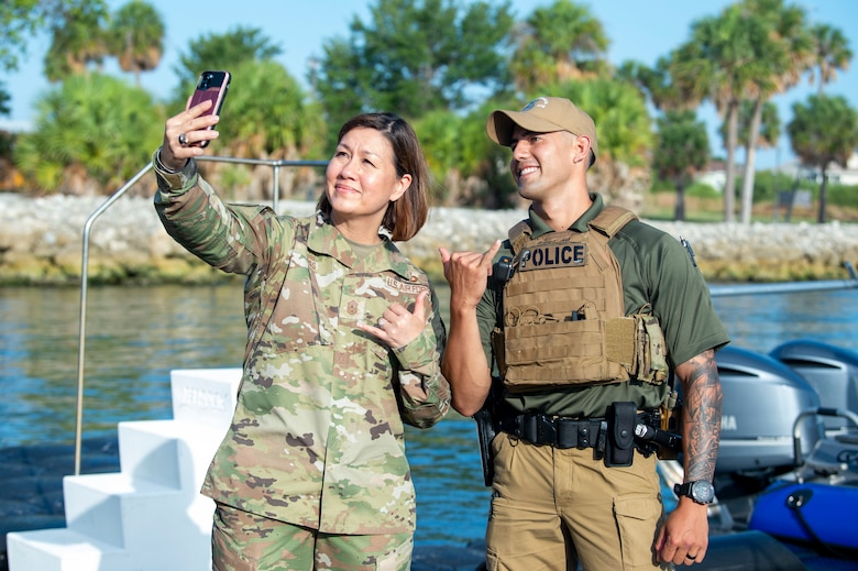 Chief Master Sgt. of the Air Force JoAnne S. Bass poses for a photo with U.S. Air Force Staff Sgt. William Au, a 6th Security Forces Squadron (SFS) marine patrolman, at MacDill Air Force Base, June 10, 2021.