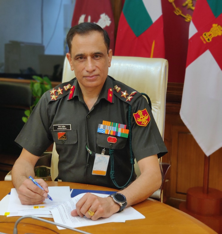 an India Ministry of Defence general officer sits at a desk