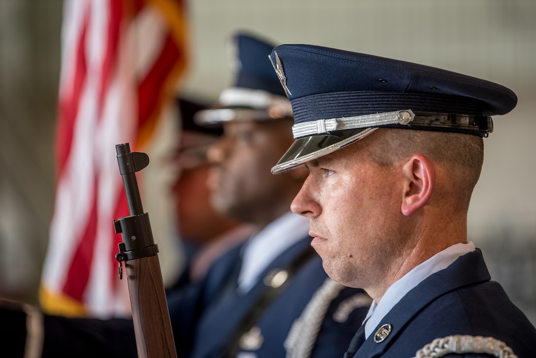 The 123rd Airlift Wing Honor Guard presents the colors during a ceremony at the Kentucky Air National Guard Base in Louisville, Ky., June 12, 2021, to bestow the Airman's Medal to Master Sgt. Daniel Keller, a combat controller in the 123rd Special Tactics Squadron. Keller earned the award for heroism in recognition of his actions to save human life following a traffic accident near Louisville in 2018. (U.S. Air National Guard photo by Tech. Sgt. Joshua Horton)