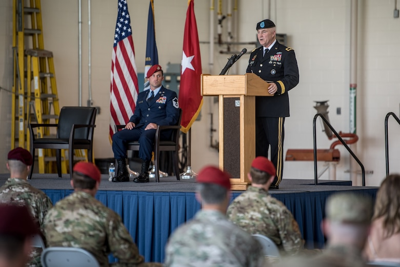 Brig. Gen. Hal Lamberton, the adjutant general for the Commonwealth of Kentucky, speaks at a ceremony commemorating the presentation of the Airman's Medal to Master Sgt. Daniel Keller, a combat controller in the 123rd Special Tactics Squadron, at the Kentucky Air National Guard Base in Louisville, Ky., June 12, 2021. Keller earned the award for heroism in recognition of his actions to save human life following a traffic accident near Louisville in 2018. (U.S. Air National Guard photo by Tech. Sgt. Joshua Horton)