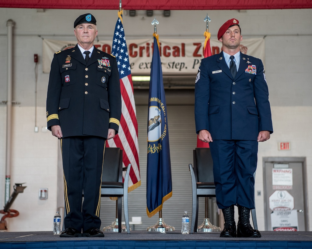 Master Sgt. Daniel Keller (right), a combat controller in the 123rd Special Tactics Squadron, prepares to receive the Airman's Medal from Brig. Gen. Hal Lamberton, the adjutant general for the Commonwealth of Kentucky, during a ceremony at the Kentucky Air National Guard Base in Louisville, Ky., June 12, 2021. Keller earned the award for heroism in recognition of his actions to save human life following a traffic accident near Louisville in 2018. (U.S. Air National Guard photo by Tech. Sgt. Joshua Horton)