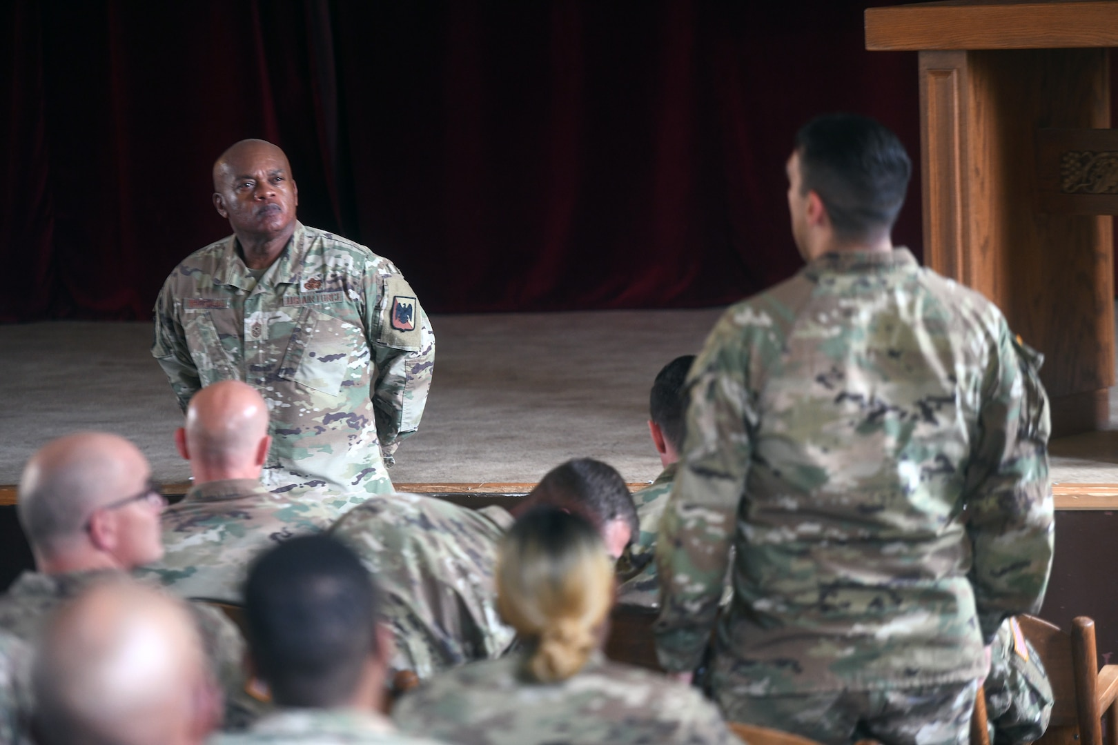 Senior Enlisted Advisor Tony Whitehead, senior enlisted advisor to the chief of the National Guard Bureau, talks with troops at a town hall during Army Gen. Daniel Hokanson's visit with National Guard troops, Powidz, Poland, June 12, 2021.