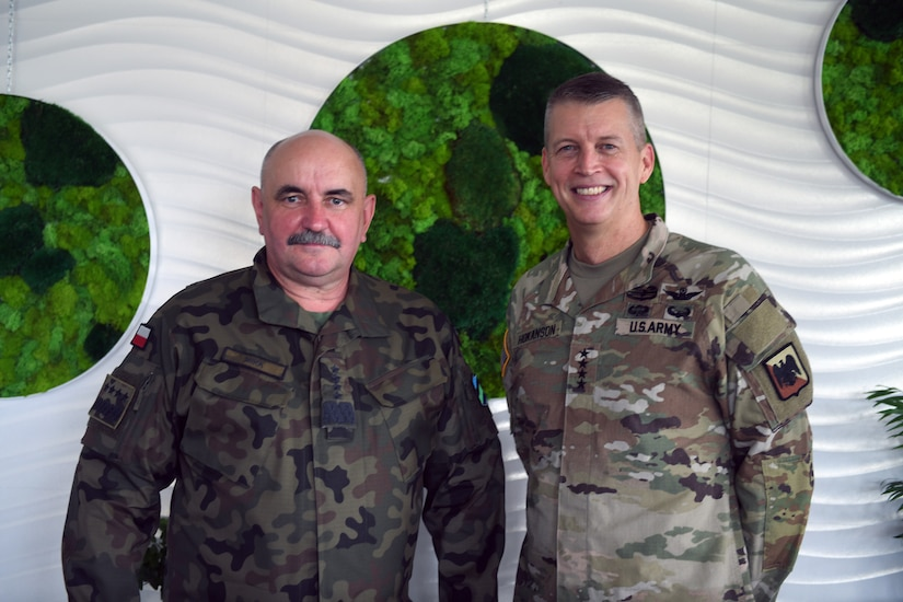 Army Gen. Daniel Hokanson, chief, National Guard Bureau, with General Commander of the Branches of the Polish Armed Forces, Gen. Jaroslaw Mika, during Hokanson's visit to National Guard troops, Powidz, Poland, June 12, 2021
