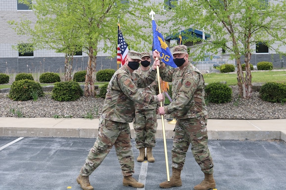 Col. Brian Lehew (right) receives the guidon of the 193rd Air Operations Group from Col. Stacey Zdanavage, 193rd Special Operations Wing Commander, in an assumption of command ceremony May 16, 2021. (Courtesy photo from 1st Lt. James O'Neill)