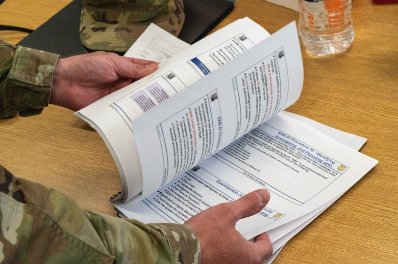 Tech. Sgt. Russell Metts, 51st Civil Engineer Squadron structural supervisor, references a guide for small unmanned aircraft systems at Osan Air Base, Republic of Korea, June 6, 2021. Operators must conduct training every 30-, 60-, and 90-day intervals to maintain their proficiency and requirements. (U.S. Air Force photo by Tech. Sgt. Nicholas Alder)