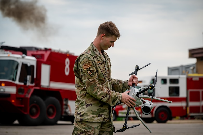 Staff Sgt. Nathan Powers, 51st Civil Engineer Squadron construction inspector technician, inspects a small unmanned aircraft system for damage after landing at Osan Air Base, Republic of Korea, June 6, 2021. Operators pilot the Aeryon SkyRanger as part of their quarterly Rapid Airfield Damage Assessment System training. (U.S. Air Force photo by Tech. Sgt. Nicholas Alder)