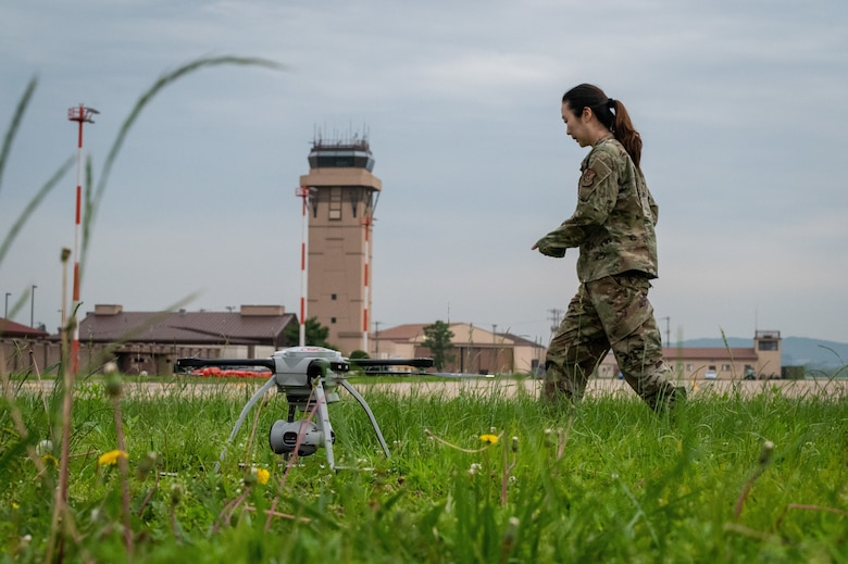 Senior Airman Clara Song, 51st Civil Engineer Squadron construction inspector, inspects small unmanned aircraft systems after landing at Osan Air Base, Republic of Korea, June 6, 2021. As a SUAS operator, Song must be proficient with operating the Aeryon SkyRanger system. (U.S. Air Force photo by Tech. Sgt. Nicholas Alder)