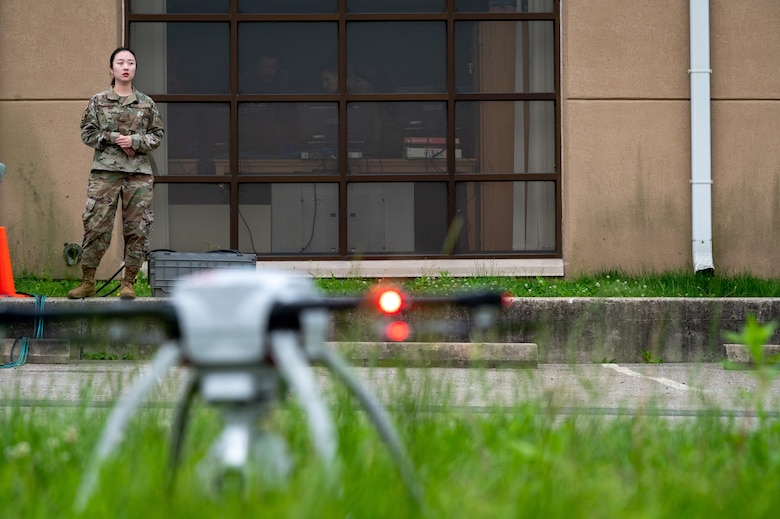 Senior Airman Clara Song, 51st Civil Engineer Squadron construction inspector, observes the takeoff of a small unmanned aircraft system at Osan Air Base, Republic of Korea, June 6, 2021. As a SUAS operator, Song must be proficient with operating the Aeryon SkyRanger system. (U.S. Air Force photo by Tech. Sgt. Nicholas Alder)