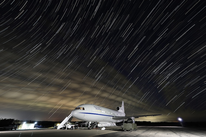 A parked plane at night.