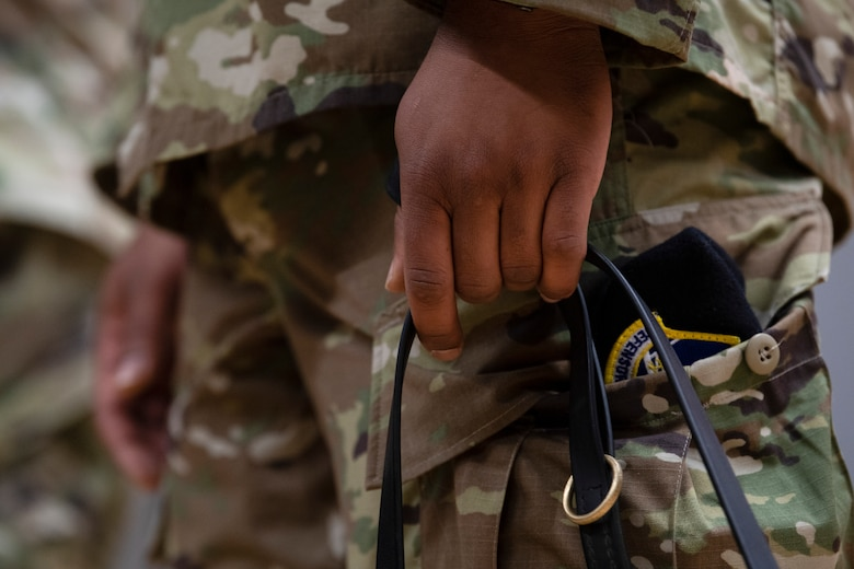 U.S. Air Force 52nd Security Forces Squadron kennel master, holds a military working dog leash.
