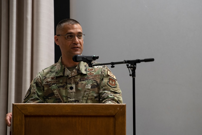 U.S. Air Force 52nd Security Forces Squadron commander speaks during a ceremony.
