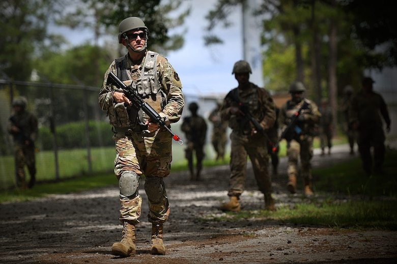 Staff Sgt. Jacob Tapley, 159th Civil Engineer Squadron, takes part in dismounted patrol tactics as part of basic combat skills training at the Air Dominance Center in Savannah, Ga., June 7, 2021. The training was led by the 159th Security Forces Squadron as part of unit operations readiness.