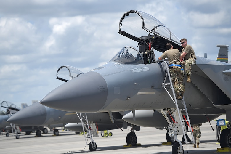 159th Maintenance Group crew chiefs inspect an F-15C in preparation for takeoff at the Air Dominance Center in Savannah, Ga., June 9, 2021. Six Louisiana Air National Guard F-15s deployed to the ADC to participate in dissimilar aircraft training, which allows pilots to hone their tactical skills with other combat airframes.