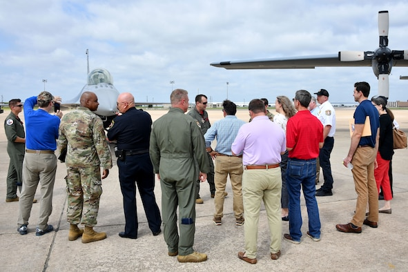 """Civic leaders from the Dallas/Fort Worth area listen to (center) Col. Korey """"Axe"""" Amundson, 301st Fighter Wing vice commander, share the 301 FW mission on June 11, 2021, at U.S. Naval Air Station Joint Reserve Base Fort Worth, Texas. The Civic Leader Day event hosted approximately 70 civilians to help them gain insight into the 301 FW's mission to train and deploy combat-ready Airmen. (U.S. Air Force photo by Staff Sgt. Randall Moose)"""