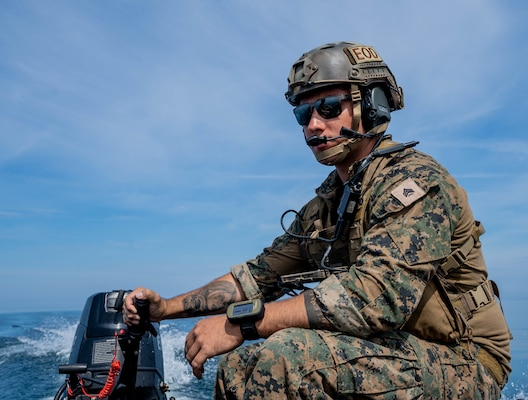 U.S. Marine Corps explosive ordnance disposal technicians release an unmanned service vehicle used for sea floor mapping and mine hunting.