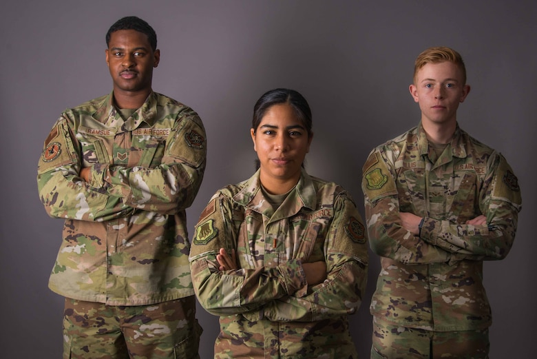 Members of Team McConnell pose for a photo June 8, 2021, at McConnell Air Force Base, Kansas. During 2020, the Air Force created diversity and inclusion task forces in units across the branch. This team of diverse Airmen across McConnell meets to discuss where the workplace could improve and what they feel is lacking throughout all rank tiers. (U.S. Air Force photo by Senior Airman Alexi Bosarge)