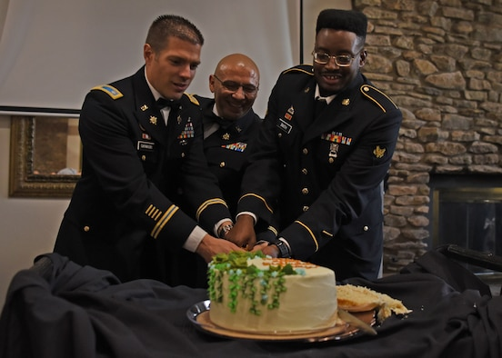 U.S. Army Lt. Col. Joseph Garwacki, 344th Military Intelligence Battalion commander, and Spc. Avion Smith, 344th MI BN student, cut the cake during the 246th Army Birthday Ball Restoration Celebration at the Bentwood Country Club in San Angelo, Texas, June 11, 2021. According to military customs, ceremonial cake cutting is traditionally done by the highest ranking individual and the lowest ranking individual in attendance.  (U.S. Air Force photo by Senior Airman Abbey Rieves)