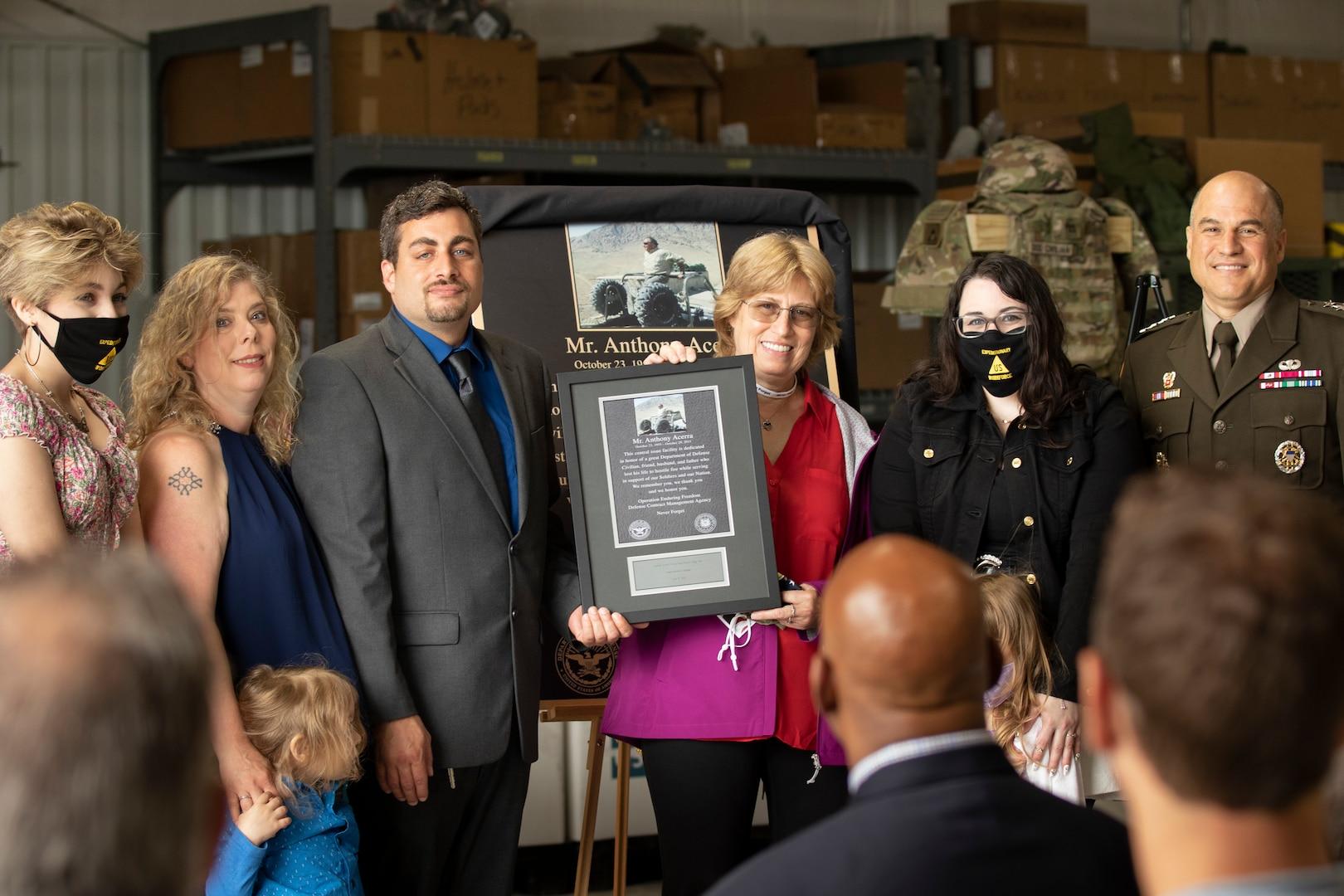 Tony Acerra's family stands with Lt. Gen. David Basset.