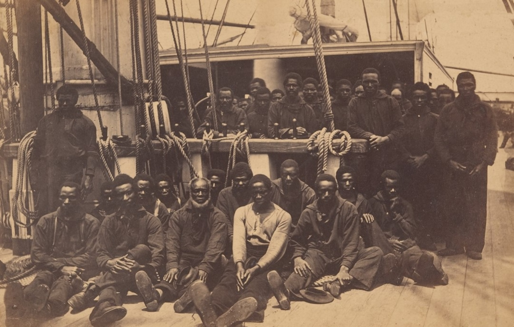 Contraband sailors on the Union Navy receiving ship USS Vermont, moored at Port Royal, South Carolina, during the Civil War. (metmuseum.org)
