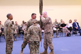 Col. Stephen A. Fabiano, commander of Area Support Group-Qatar,  passes the ASG-Qatar cased colors to Maj. Gen. John P. Sullivan, commander of the 1st Theater Sustainment Command, symbolizing the return of the command to his superior officer at a June 10, 2021 end of mission ceremony, CampAsSayliyah, Qatar. The Army established ASG-Qatar in 1992, and for the last three decades the military and civilian personnel deployed there supported military and humanitarian operations in the region. ASG-Qatar merged with ASG-Jordan as part of the Army's ongoing realignment of assets and personnel. (U.S. Army photo by David Gomes)