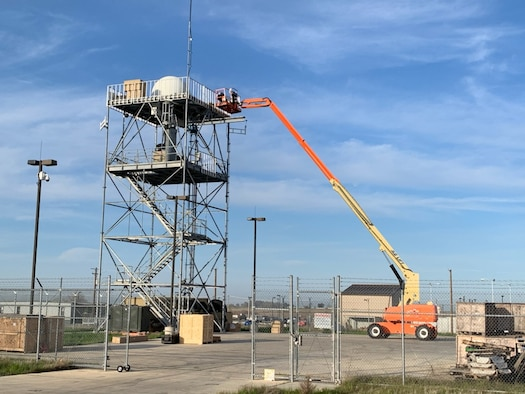 L3 Harris Communication Systems-West personnel make final touches to the remote equipment group of the Distributed Common Ground System Distributed Surface Asset (DDSA) on Beale Air Force Base