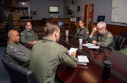Rear Adm. John F. Meier, Commander, Naval Air Force Atlantic, is briefed for a flight by Lt. Johnathan Neal