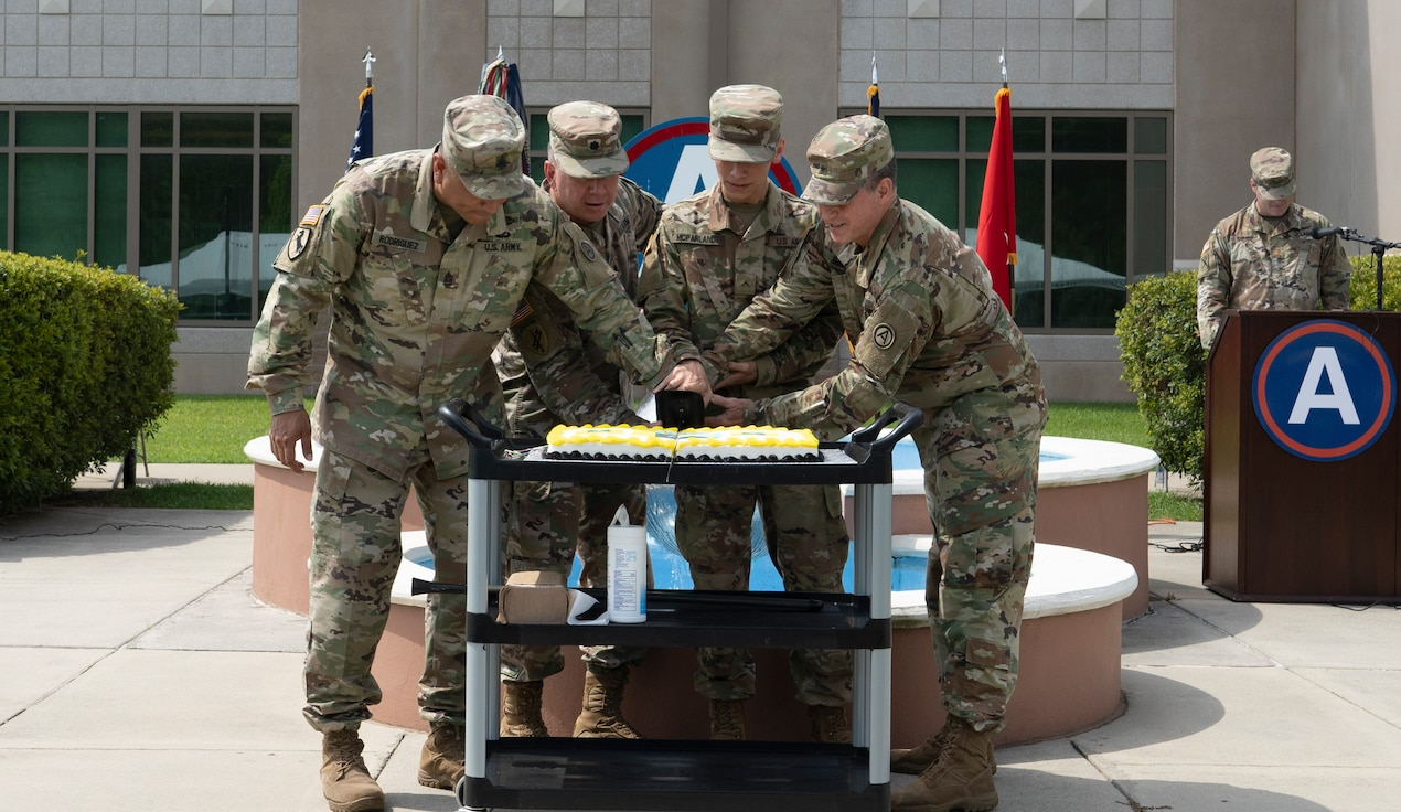 U.S. Army Central (USARCENT) hosts a cake cutting to commemorate the 246th Army birthday at Shaw Air Force Base in Sumter, S.C. on June 14th, 2021. From left to right, Command Sgt. Maj. Joserolando Rodriguez, Lt. Col. Kenneth Boes, Pvt. Archie McParland and Brig. Gen. Brian Davis cut the cake, respectively participating in a time-honored tradition representing the Army's past and continued success in the future. (U.S. Army photo by Sgt. Leo Jenkins)