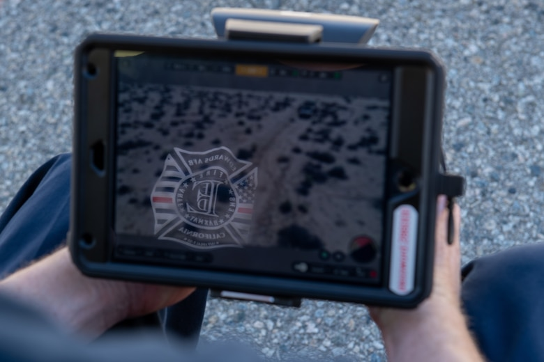 A digital tablet displays an image of an exercise scenario during an 812th Civil Engineering Squadron interoperability exercise on North Base at Edwards Air Force Base, California, June 4.