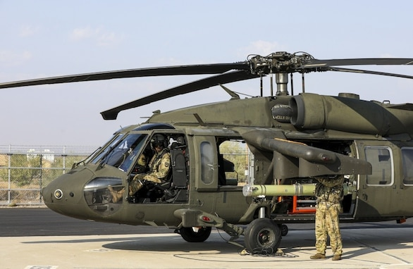 An Air Launched Effects system is loaded onto a UH-60L Black Hawk as capabilities testing commences during the first series of Project Convergence exercises at Yuma Proving Ground, Ariz., Sept. 15, 2020. The Project Convergence 21 demonstrations are scheduled to begin in November 2021.