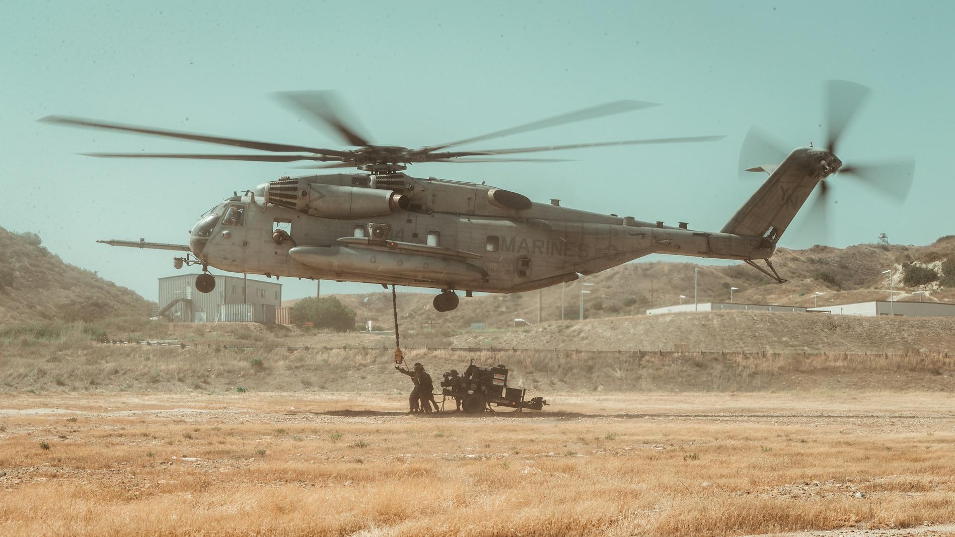 U.S. Marines with 1st Landing Support Battalion conduct an external lift of a bulk fuel pump