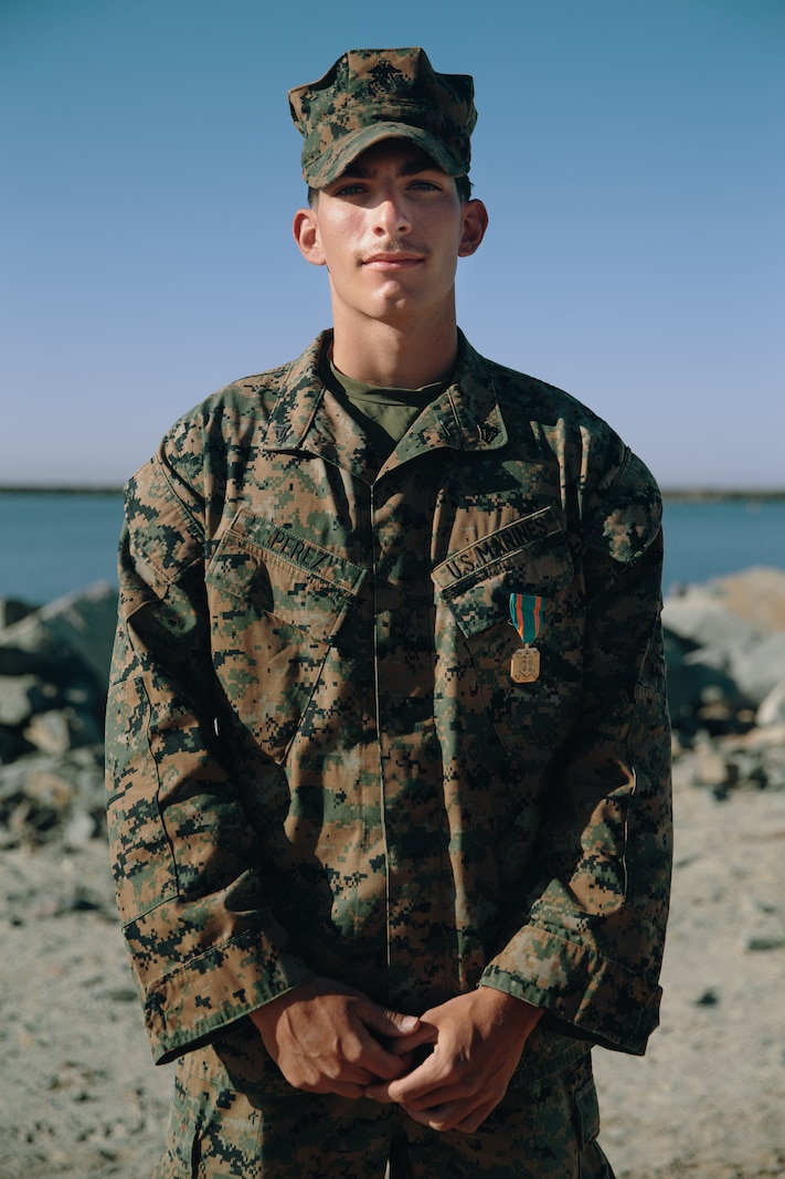 U.S. Marine Corps Cpl. Jordan Perez receives the Navy and Marine Corps Achievement Medal
